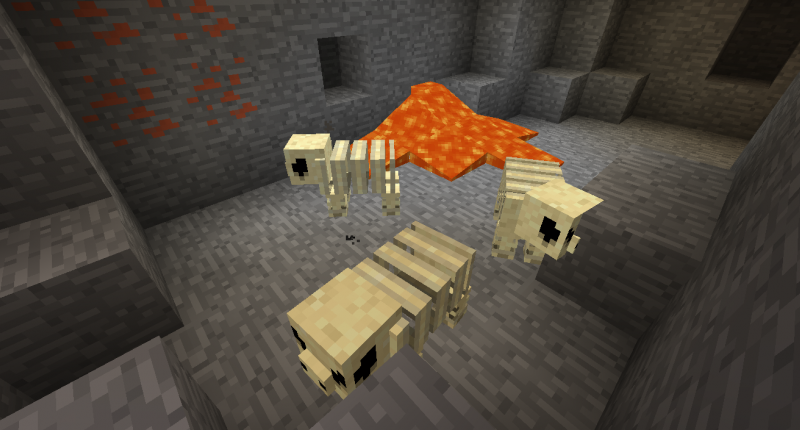 Fossil Monsters walk around near a pool of lava and some copper ore.