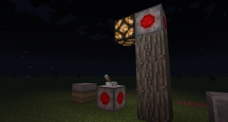 A redstone lamp connected to a lever on the ground through wireless redstone