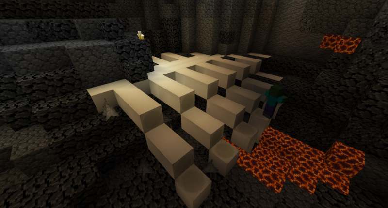 A huge skeleton on the cave floor